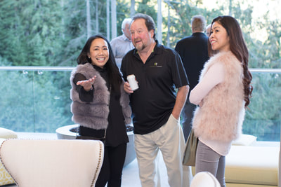 Guests mingling at the TEN80 Luxury Net Zero Networking Event. Energy efficiency, tesla powerwall, green building, luxury listing for sale.