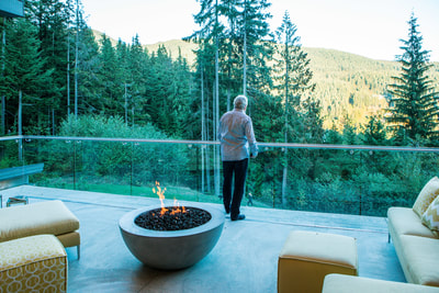 Guest enjoying the view at the TEN80 Luxury Net Zero Networking Event. Energy efficiency, tesla powerwall, green building, rainwater harvesting, luxury listing for sale.