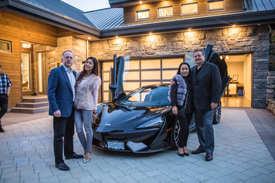 Guests mingling at the TEN80 Luxury Net Zero Networking Event. Energy efficiency, tesla powerwall, green building, McLaren, luxury listing for sale.
